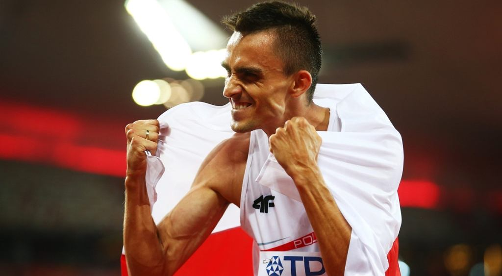 epa04897439 Adam Kszczot of Poland celebrates after placing second in the men's 800m final during the Beijing 2015 IAAF World Championships at the National Stadium, also known as Bird's Nest, in Beijing, China, 25 August 2015. EPA/SRDJAN SUKI Dostawca: PAP/EPA.