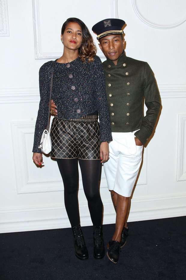 In this image released by Starpix, Helen Lasichanh, left, and Pharrell Williams arrive at the Chanel Paris-Salzburg 2014/15 Metiers d'Art Collection fashion show at the Park Avenue Armory on Tuesday, March 31, 2015, in New York.  (AP Photo/Starpix, Kristina Bumphrey)