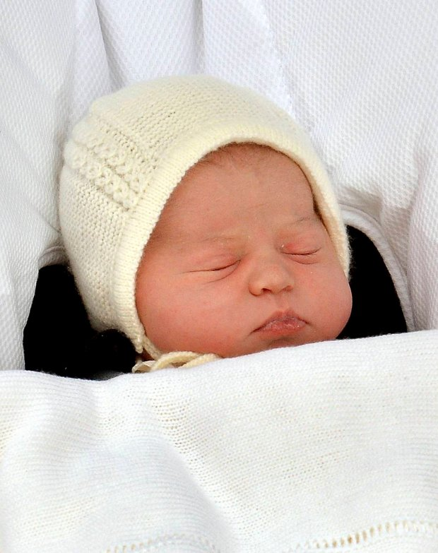 The baby daughter of Britain's Prince William and Catherine, Duchess of Cambridge, sleeps as she is carried in a car seat from the Lindo Wing of St Mary's Hospital, in London, Britain May 2, 2015. The Duchess of Cambridge, gave birth to a girl on Saturday, the couple's second child and a sister to one-year-old Prince George.       REUTERS/John Stillwell/pool  TPX IMAGES OF THE DAY