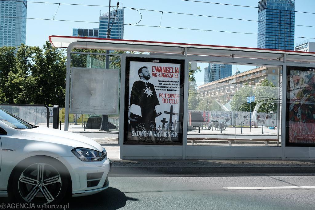 Plakat z Łukaszem Szumowskim