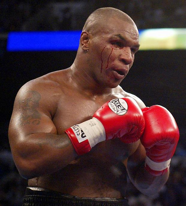 PHOTO:EAST NEWS/AFP  Challenger Mike Tyson of the US bleeds around the right eye from a punch from heavyweight champion Lennox Lewis during their World Heavyweight Championship fight 08 June 2002 at The Pyramid in Memphis, TN. Lewis won by knockout in the eighth round