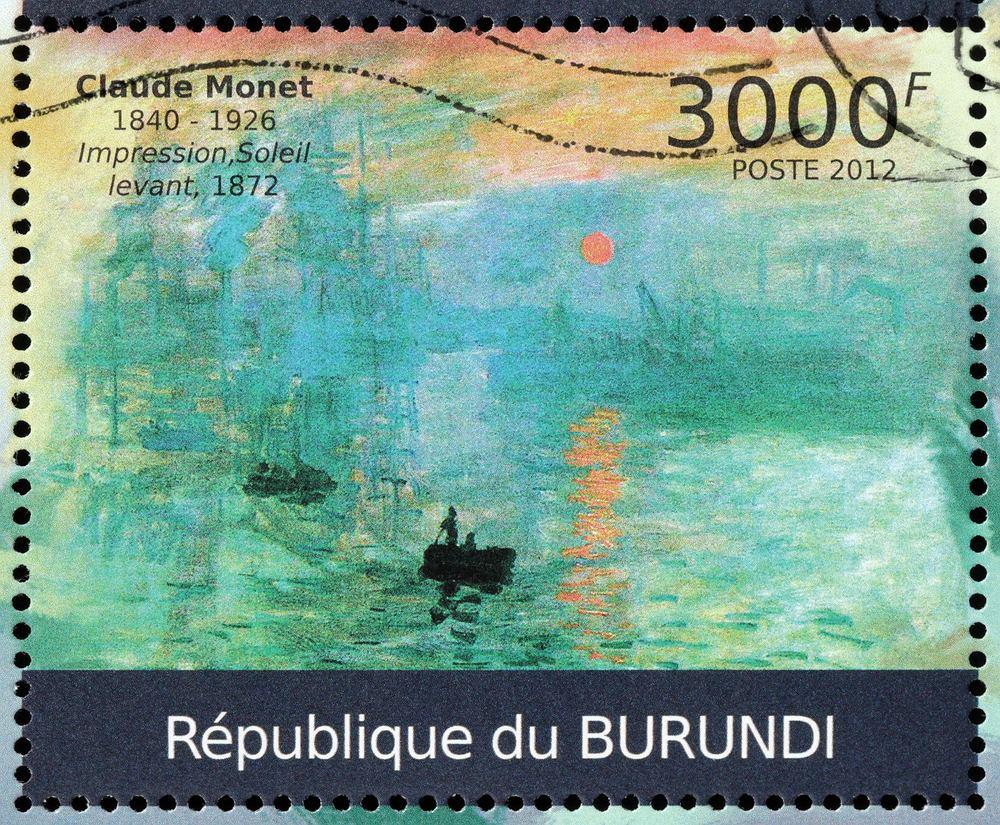 'Impresja, wschód słońca' Claude'a Moneta na znaczku pocztowym. Zdjęcie ilustracyjne