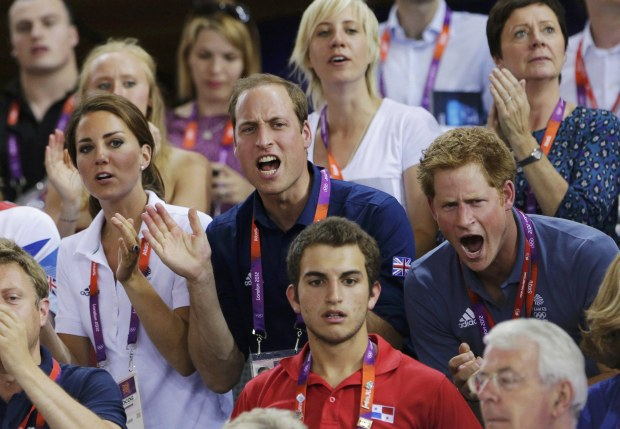 Britain's Prince William (C), his wife Catherine (L), Duchess of Cambridge and Prince Harry cheer for the British team as they watch the track cycling event at the Velodrome during the London 2012 Olympic Games August 2, 2012.  REUTERS/Cathal McNaughton (BRITAIN  - Tags: OLYMPICS SPORT CYCLING ROYALS)