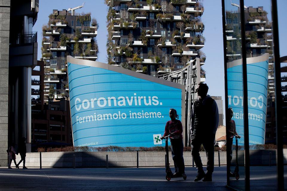 'Zatrzymajmy razem koronawirusa' głosi napis w Mediolanie.