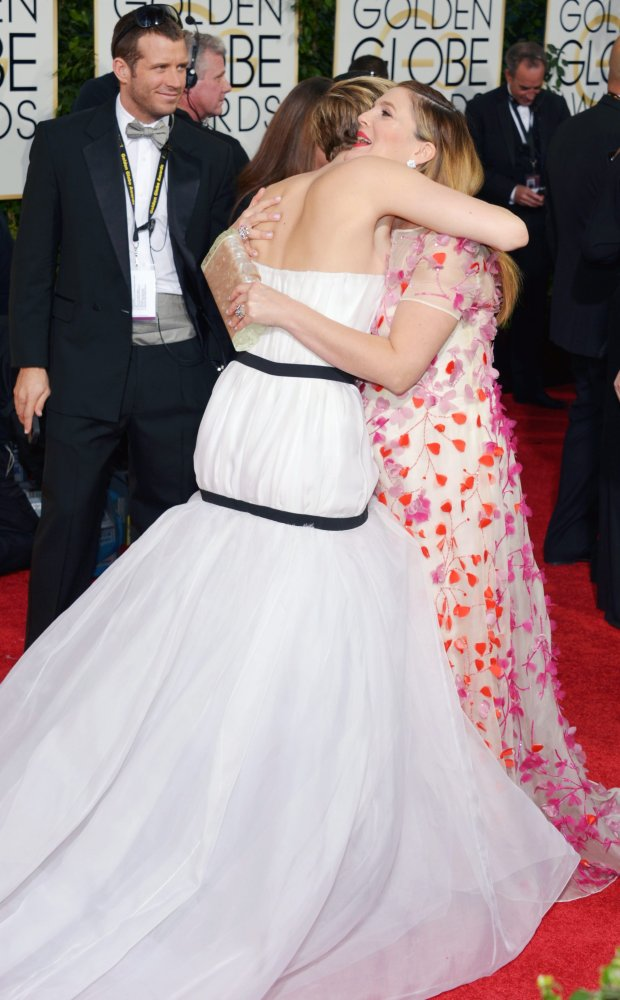 Jennifer Lawrence, left, and Drew Barrymore arrive at the 71st annual Golden Globe Awards at the Beverly Hilton Hotel on Sunday, Jan. 12, 2014, in Beverly Hills, Calif. (Photo by John Shearer/Invision/AP)