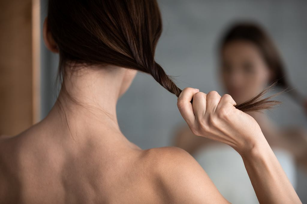8Rear,View,Close,Up,Woman,Holding,Long,Straight,Thin,Hair