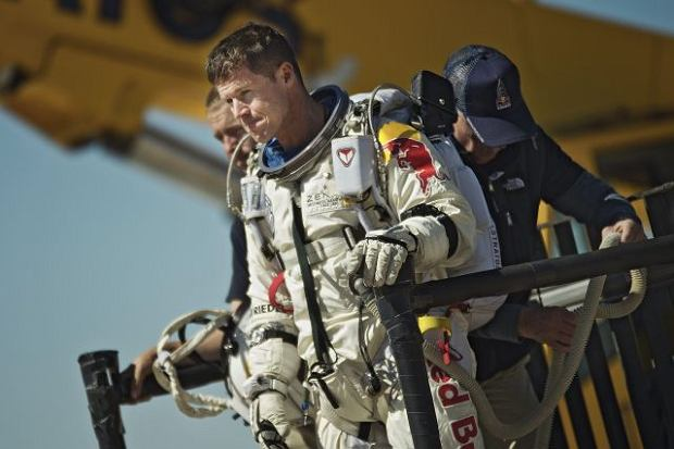 FILE - This photo provided by Red Bull Stratos shows pilot Felix Baumgartner of Austria reacting after his mission was aborted in Roswell, N.M., on Oct. 9, 2012.  on Sunday, Oct. 14, 2012,  mission control officials declared a
