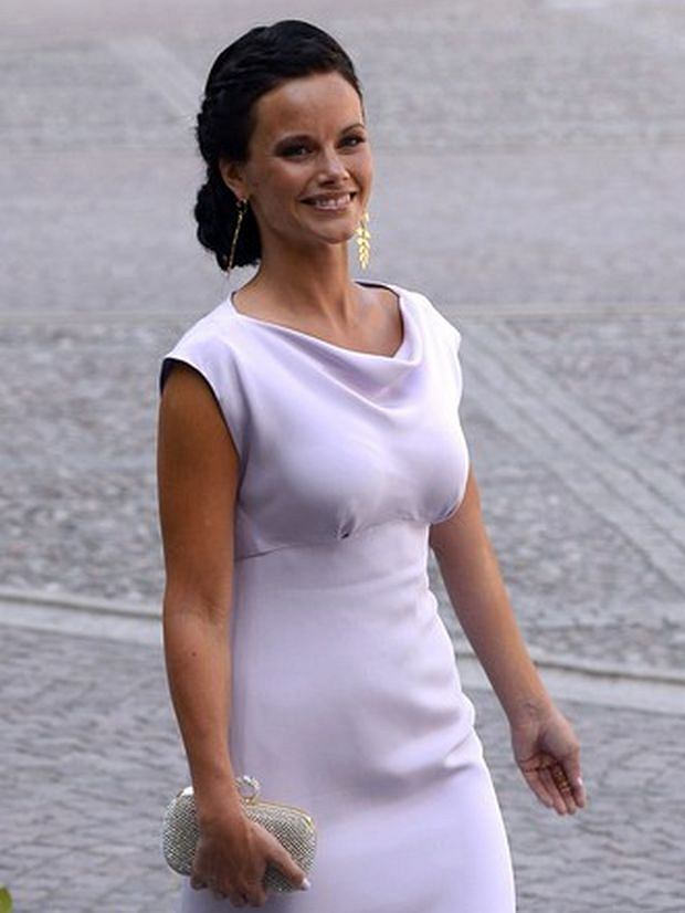 Sofia Hellqvist, girlfriend of Prince Carl Philip of Sweden arrives on June 8, 2013 to the Royal church for Princess Madeleine of Sweden and Christopher O'Neill 's wedding cermony at the Royal castle in Stockholm, June 8, 2013.  AFP PHOTO / JONATHAN NACKSTRAND