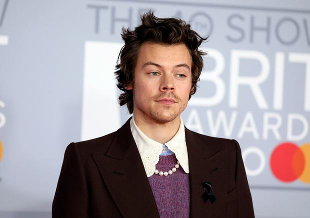 Harry Styles poses for photographers upon arrival at Brit Awards 2020 in London, Tuesday, Feb. 18, 2020.(Photo by Vianney Le Caer/Invision/AP)