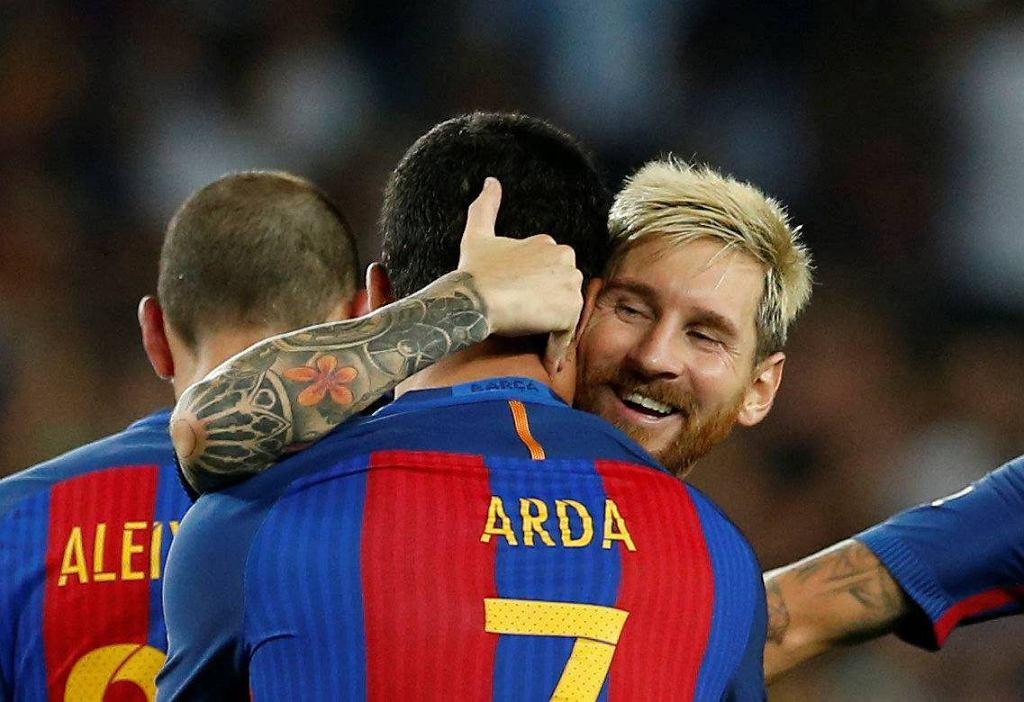 Arda Turan i Leo Messi