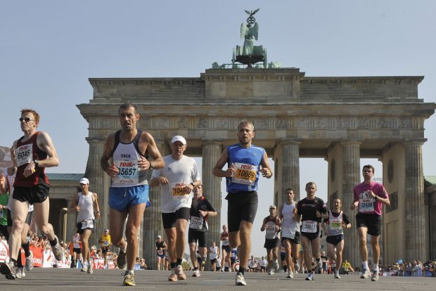 Runners pass the Brandenburg Gate during the 36th Berlin Marathon in Berlin, Germany, Sunday, Sept. 20, 2009. Some 40,000 runners take part in the competition. (ddp images/AP Photo/Gero Breloer)