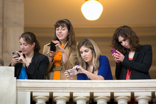 As Britain's Prince Harry tours an exhibition by the HALO Trust on Capitol Hill in Washington, journalists record the event from a balcony in the rotunda of the Russell Senate Office Building, Thursday, May 9, 2013. The HALO Trust is a British charity dedicated to removing the debris left behind by war, in particular, landmines and unexploded ordnance that might present a danger to civilians.  (AP Photo/J. Scott Applewhite)