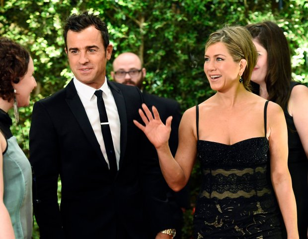 Actor Justin Theroux (L) and actress Jennifer Aniston attend the Academy of Motion Picture Arts and Sciences Governors Awards in Los Angeles, California November 8, 2014.  REUTERS/Kevork Djansezian (UNITED STATES - Tags: ENTERTAINMENT)