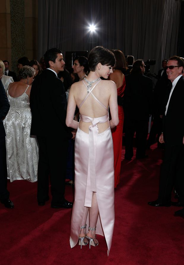 Actress Anne Hathaway arrives at the Oscars at the Dolby Theatre on Sunday Feb. 24, 2013, in Los Angeles. (Photo by Todd Williamson/Invision/AP)