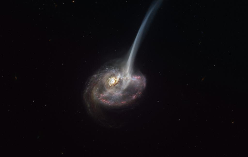 Ilustracja przedstawiająca galaktykę ID2299 w trakcie kolizji