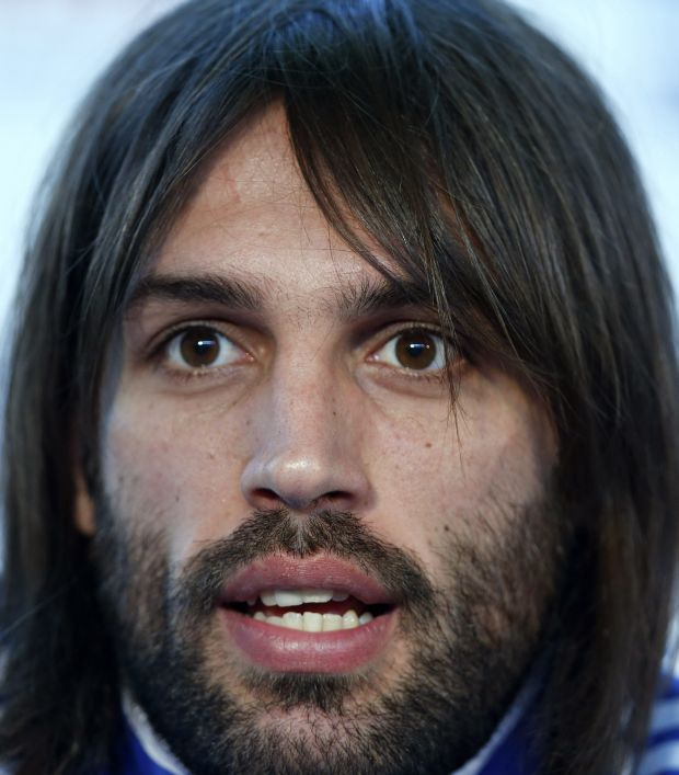 Greece's Georgios Samaras speaks during a news conference at the Euro 2012 soccer championship in Legionowo about 25 kilometers (15 miles) north of Warsaw, Poland on Tuesday, June 19, 2012. (AP Photo/Thanassis Stavrakis)