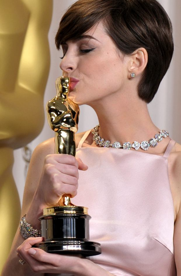 """Anne Hathaway poses with her award for best actress in a supporting role for """"Les Miserables"""" during the Oscars at the Dolby Theatre on Sunday Feb. 24, 2013, in Los Angeles. (Photo by John Shearer/Invision/AP)"""