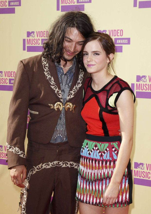 Actress Emma Watson with actor Ezra Miller   arrive at the 2012 MTV Video Music Awards in Los Angeles, September 6, 2012.  REUTERS/Mario Anzuoni    (UNITED STATES  - Tags: ENTERTAINMENT)  (MTV-ARRIVALS)