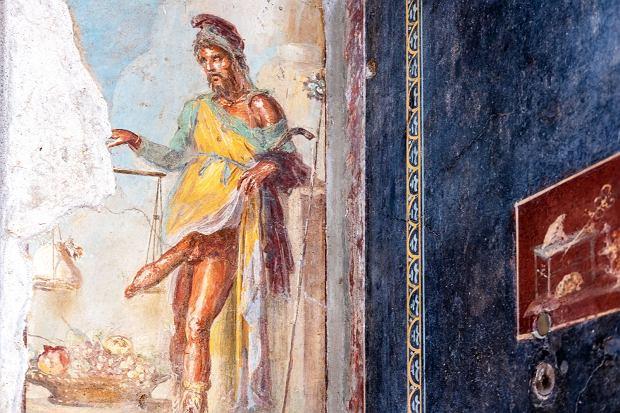 Starożytny fresk przedstawiający rzymskiego boga Priapusa z Pompei, zniszczony przez erupcję Wezuwiusza w 79 r. p.n.e. / Fot. BlackMac/Shutterstock.com
