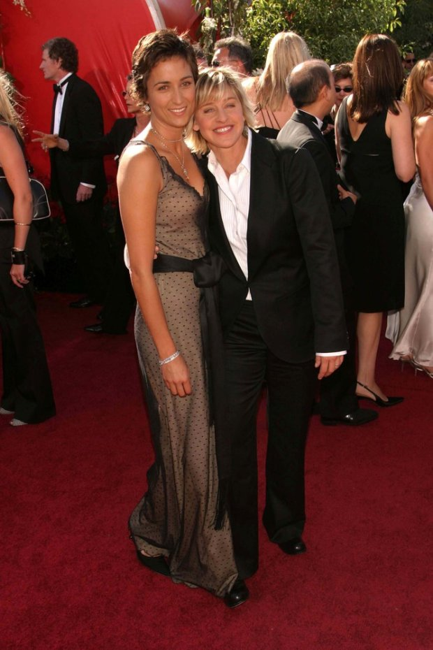 Ellen De Generes and girlfriend Alexandra Hedison arrive on the red carpet for the 56th Annual Primetime Emmy Awards presented by the Academy of Television Arts & Sciences at the Shrine Auditorium in Los Angeles on Sunday, September 19, 2004 (AP Photo/Mirek Towski/DMI via AP)