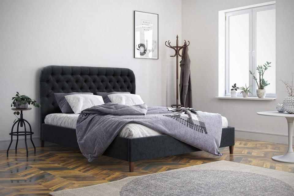 Łóżko tapicerowane Almar z zaokrąglonym zagłówkiem.