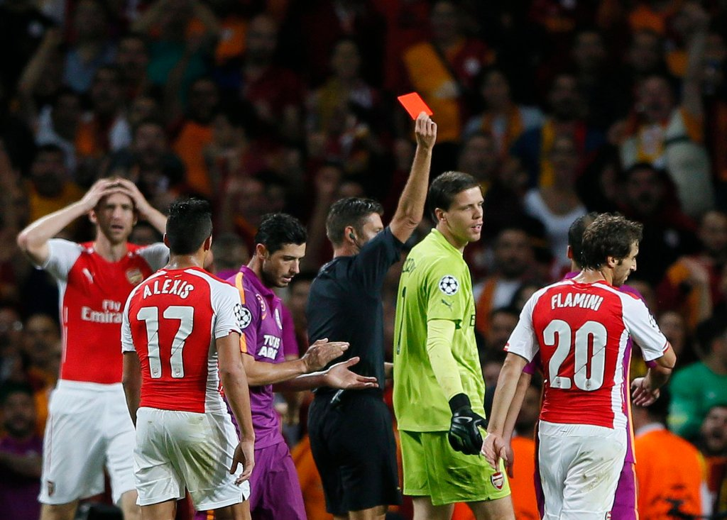 Arsenal goalkeeper Szczesny is shown a red card by match referee Rocchi during their Champions League soccer match against Galatasaray at the Emirates Stadium in London
